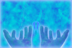 Hands of healing. On the blue background Royalty Free Stock Photos