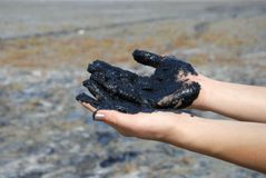 Hands with healing mud Stock Photo