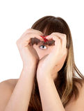 Hands heart. The girl looks through hands symbolizing heart Stock Photography
