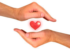 Hands with heart Stock Photography