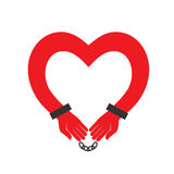 Hands heart in handcuffs. Royalty Free Stock Images