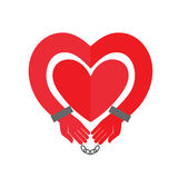Hands heart in handcuffs. Royalty Free Stock Photos