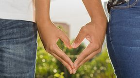 HANDS HEART LOVE ARMS LEGS. BOKEH PLANTS TEXTURE FINGER NAILS royalty free stock photo