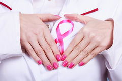 Hands heart on pink ribbon symbol Stock Image