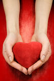 Hands with heart on red Stock Photography