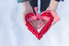 Hands with heart. Red wicker heart in hands Stock Image