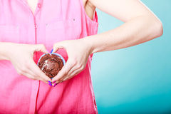 Hands heart shape with muffin. Confectionery. Royalty Free Stock Photos