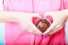 Hands heart shape with muffin. Confectionery. Stock Photos