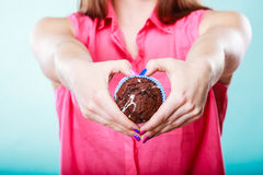Hands heart shape with muffin. Confectionery. Royalty Free Stock Photography
