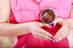 Hands heart shape with muffin. Confectionery. Stock Image