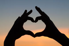 Hands in heart shape Stock Photos