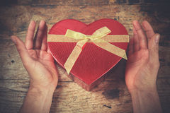 Hands and heart shaped box Royalty Free Stock Image