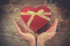 Hands and heart shaped box Stock Photography