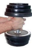 Hands with a heavy dumbbell Royalty Free Stock Photo