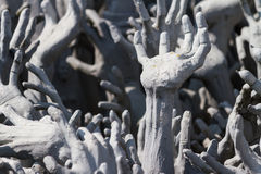 Hands from hell at Wat Rong Khun Stock Images