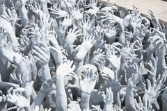 Hands from Hell in the White Temple, Chiang Rai Stock Photo