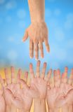 Hands of help over bright Stock Photography