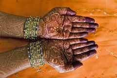 Hands with henna design. Hands of a Indian bride with henna design and bangles Royalty Free Stock Images