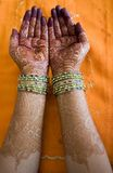 Hands with henna design. Hands of a Indian bride with henna design and bangles Royalty Free Stock Photography