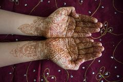 Hands with henna design stock photos