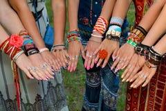 Hands of hippie Stock Images