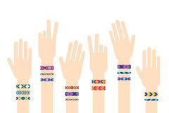 Hands with hippy friendship bracelets Stock Photo