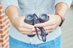 Binoculars. Hands of a hipster with binoculars Stock Images