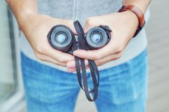 Binoculars. Hands of a hipster with binoculars Royalty Free Stock Photos