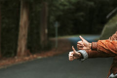 Hands hitchhike signal. People travel concept Royalty Free Stock Photo