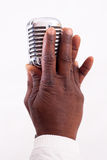 Hands hod a microphone Stock Photos
