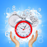 Hands hold alarm clock Royalty Free Stock Photography