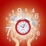 Hands hold alarm clock Stock Image