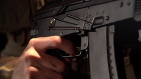 Hands Hold an Automatic Rifle And Shoot stock footage