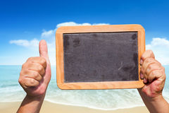 Hands hold a blank slate blackboard in the air Royalty Free Stock Photo