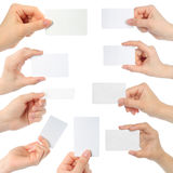 Hands hold business cards Royalty Free Stock Images