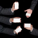 Hands hold business cards collage on black Royalty Free Stock Photos