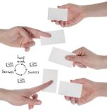 Hands hold business cards on white background stock photography