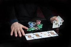 Hands hold the cards. The hands hold the cards in the game of Poker Stock Photos