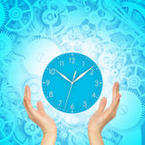 Hands hold clock Stock Photography
