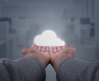 Hands hold a cloud. Two hands, seen firsthand support an abstract rescue system Royalty Free Stock Photos