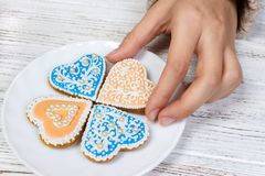 Hands hold cookies in form of heart royalty free stock photo