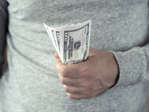 Hands hold dollars Royalty Free Stock Photography