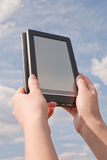 Hands hold electronic book reader Stock Photo
