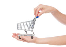 Hands hold empty shopping cart for sale. Isolated on a white background Stock Photos