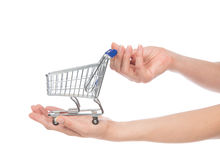 Hands hold empty shopping cart for sale. Isolated on a white background Royalty Free Stock Image
