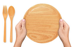 Hands hold Empty wood plate on white. Background Royalty Free Stock Photography