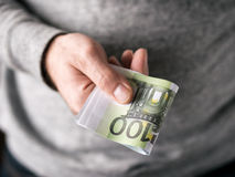 Hands hold Euro Stock Photo