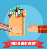 Hands hold food package. Royalty Free Stock Photo
