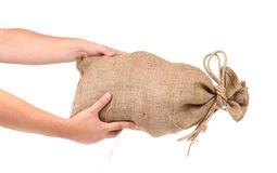 Hands hold full bag with money. Royalty Free Stock Image