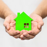 Hands hold green house Royalty Free Stock Images